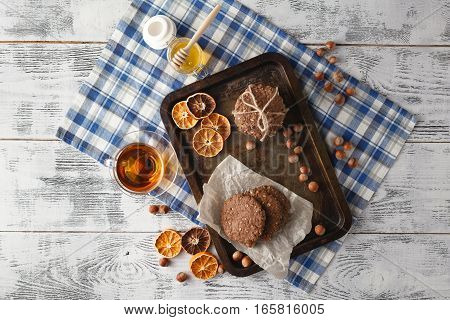 Fresh Oat Cookies With Honey And Cup Of Tea On White Table