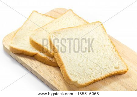 Slices of toast bread on breadboard wooden, isolated on white background