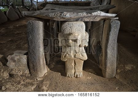 ancient pre-columbian tom with statue in ALtos de los Idolos San Agustin Colombia