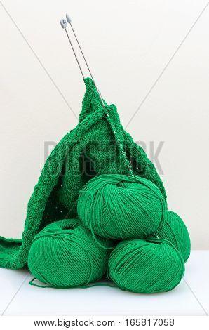 Ball of Yarn and Knitting Needles fisherman's rib knitting pattern