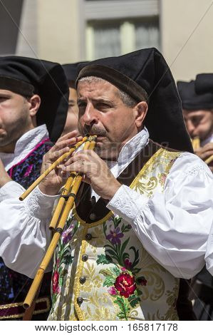 CAGLIARI, ITALY - May 1, 2015: 359 Religious Procession of Sant'Efisio - Sardinia - portrait of a launeddas musician in traditional Sardinian costume