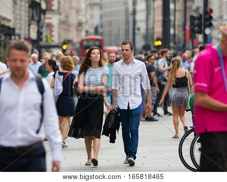 London, UK - August 24, 2016:  Young couple walking in the Leicester square