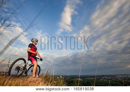 Cross Country Biker Is Resting On Top Of The Hill