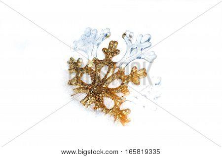 Snowflake golden in snow on white background.