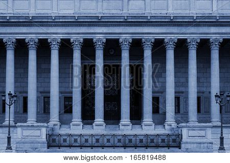 Neoclassical building front with corinthian columns colonnade, resembling a Greek or Roman temple. By architectural style it looks like a government or other public facility as a college / university, administration building or law court.