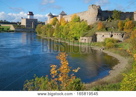Sunny autumn day on the river Narva. Views of Herman's castle (Estonia) and Ivangorod fortress (Russia)