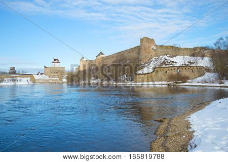 Herman's Castle (Estonia) and Ivangorod fortress (Russia) on the border river Narva March afternoon