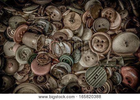 Selection of old buttons in a tin