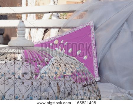 White bench with cage and pillow, shabby chic