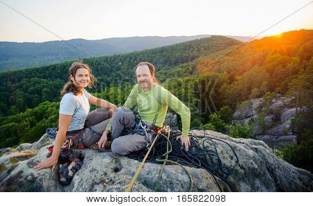 Couple Of Climbers Resting And Enjoying Beautiful Nature View