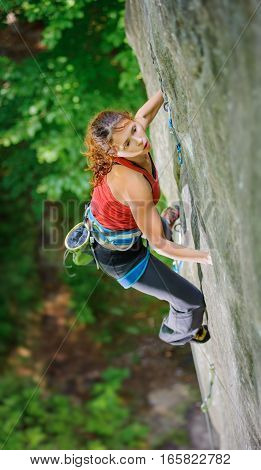 Beautiful Woman Climber Climbing Steep Rock With Rope