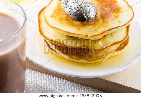 Glass Mug Of Hot Cocoa And Pancakes With Honey