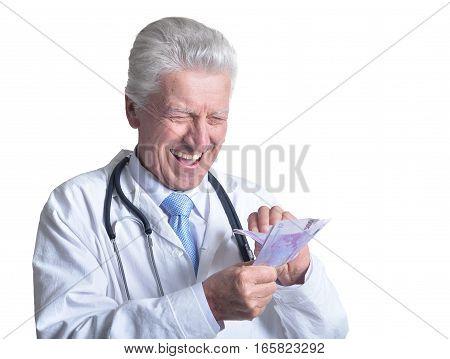 senior male doctor posing against white background