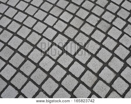 Square gypsum brick stone pattern on the street wall texture