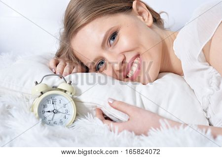 Young beautiful woman posing in bad, home interior