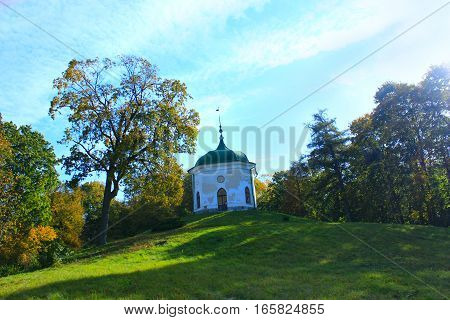Beautiful Glinka's gazebo in Kachanivka park among trees