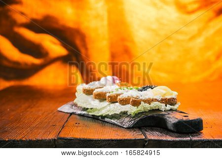 Natural appetizer of cottage cheese sandwiches. Fire lighting background