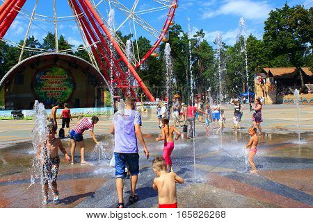 Kharkiv / Ukraine. 07 August 2016: children playing on the playground with their parents with fountains in Gorky Park in Kharkiv. 07 August 2016 in Kharkiv / Ukraine.