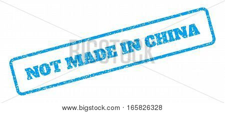 Blue rubber seal stamp with Not Made In China text. Vector tag inside rounded rectangular banner. Grunge design and unclean texture for watermark labels. Inclined emblem on a white background.
