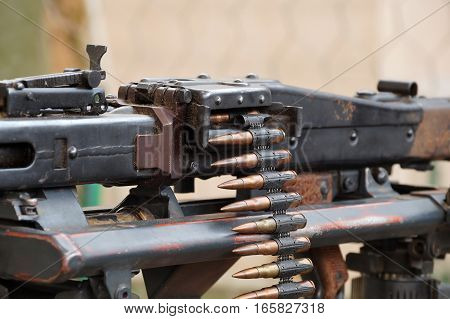 Tape with bullets filled in the German machine gun of times of World War II