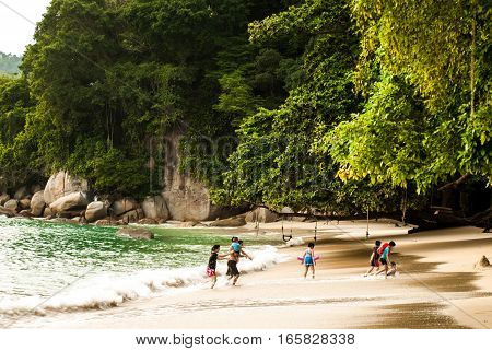 Afternoon on beach, Pulau Pangkor, Malaysia, children playing - July 2015