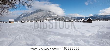 snowy valley bottom with wooden cabins winter landscape near garmisch bavaria
