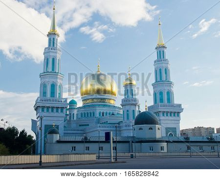 Mosque With Golden Domes Against The Sky