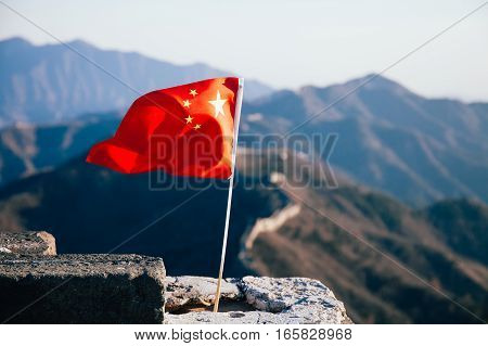 China Flag Waving Over The Great Wall Of China In The Background