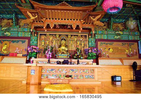 January 12, 2017 in Tehachapi, CA:  Inside a Buddhist temple building which has colorful Zen spiritual decorations including a Buddha Statue taken at Tae Go Sah Buddhist Monastery where people can meditate daily and attend Sunday services in Tehachapi, CA
