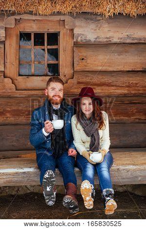 Happy couple drinking tea wood house close up