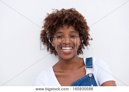 African Woman Smiling Against Isolated White Background