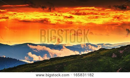 Red orange sky in sunset evening time picturesque and dramatic Carpathian mountains landscape Ukraine