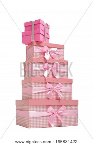 stack of pink gift boxes with satin ribbons on  white background.