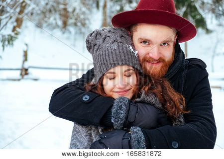 Portrait of a loving couple on a winter background beautiful couple in love.
