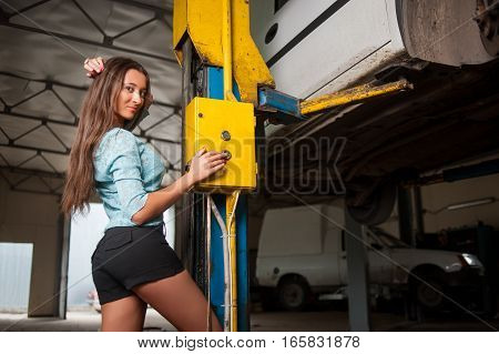 Sexy Beautiful Girl In The Auto Repair Shop
