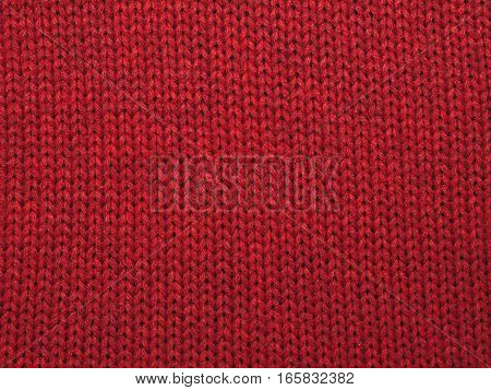 Christmas background from red knitted red wool closeup