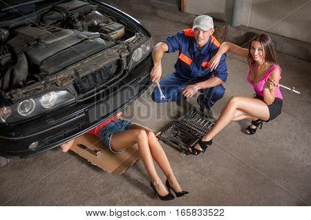 Fixing Car At Auto Repair Shop
