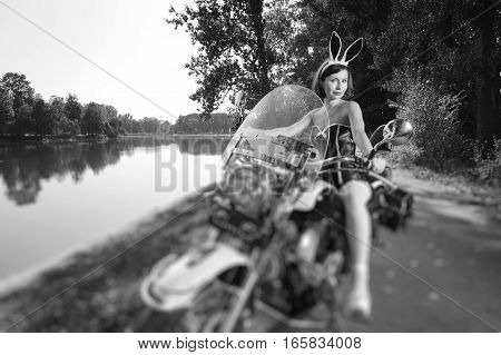 Sexy Woman On Cruiser Motorcycle Near The Lake