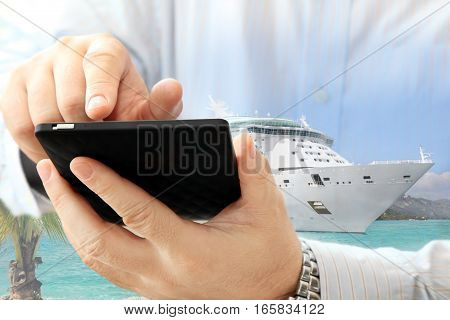 Close up of man using smartphone on cruise ship background