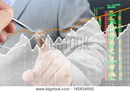 Businessmen analyzing financial chart on virtual screen