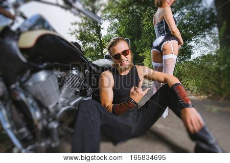 Portrait Of Brutal Biker And Sexy Girl With Motorcycle