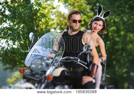 Portrait Of Sexy Couple Of Bikers On The Motorcycle