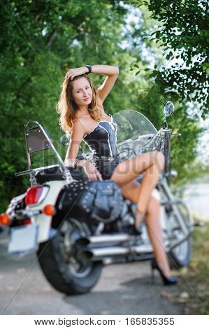 Attractive Young Woman With The Cruiser Motorcycle