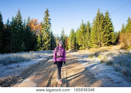Young Woman Hiker Walking On A Mountain Road