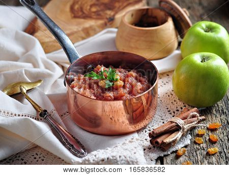 Homemade apple chutney with raisins, cinnamon, chili and other spices.