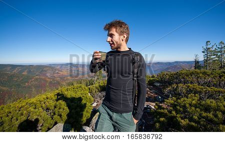 Portrait Of Young Fit Male Hiker Drinking Tea