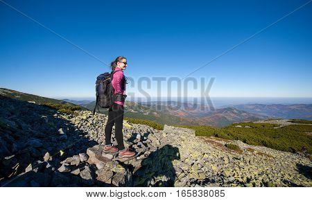 Woman Backpacker On Rocky Mountain Peak