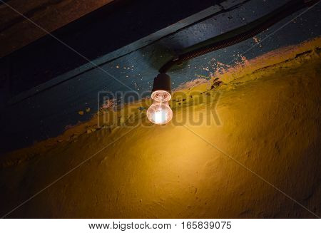 The yellowish light of incandescent lamps at dusk on the street. Light Ilyich - incandescent lamp - lamp Edison.