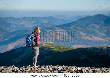 Woman Backpacker Enjoying The Open View On The Mountains
