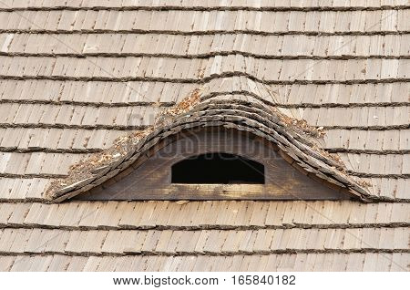 Detail of the old reed roof and dormant - squint window